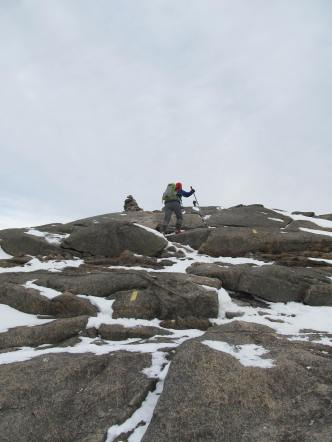 Anya making her way up to the summit, following the cairns.
