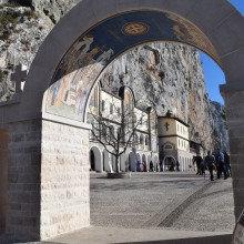 The entrance to the monastery. Bob has the cane and Slavko is in the purple shirt beyond the gate.