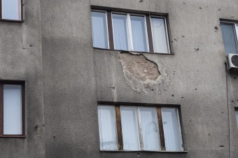 Something bigger than bullets hit this building.