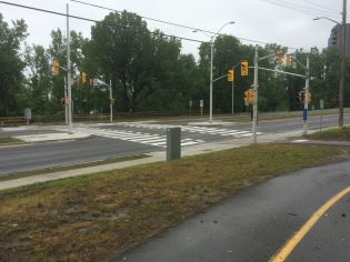 A couple of years ago, the City of Ottawa put in these lights at a designated bicycle crossing. I love it. This road (Carling Avenue) was horrendous to try and cross before.
