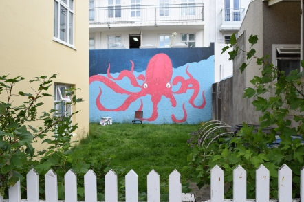 This wall had to be repaired and when it was finished the owner thought it was very white. So she hired her 19-year-old neighbour to paint something on it.