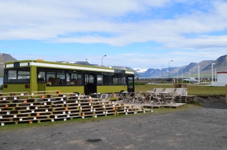 Simbahollin's outdoor seating. Creative use of pallets and an old bus.