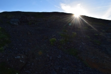 The sun peaks over the final steep-ish incline.