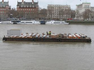 One of the barges near the embankment that carries a mere fraction of the fireworks that will be detonated.