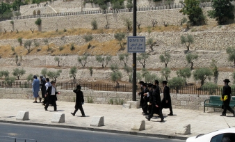 Ultra-orthodox Jews walking toward the Mount of Olives.