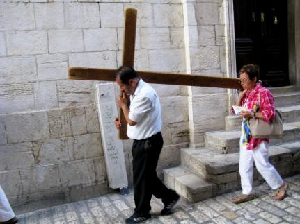 Pilgrims walk the Way of the Cross.
