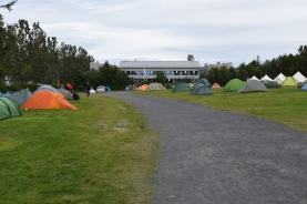 That's the hostel beyond the campground. The grass makes for really easy sleeping.