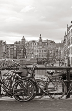A typical canal scene in Amsterdam. The Bloemenmarkt floats in the background.