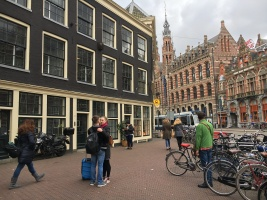 Bob stops to look at Magna Plaza. This magnificent building was once the main post office of Amsterdam and is now a shopping plaza.