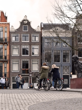 An iconic scene in Amsterdam - bicycles, Multatuli and tall, skinny buildings.