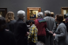 The Rijksmuseum holds paintings of the Dutch masters. Museum-goers take in Vermeer's The Milkmaid.
