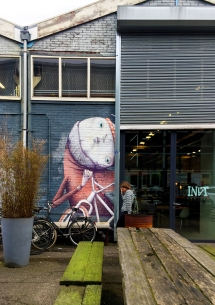 Beautiful art on the walls of the industrial buildings add cultural flavour to Noord.