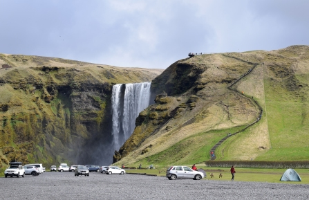 Skogafoss. The stairs to the platform at the top of the waterfall is to the right. The tent campground is to the right of the parking lot.